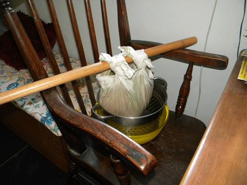 Straining apples through jelly bag