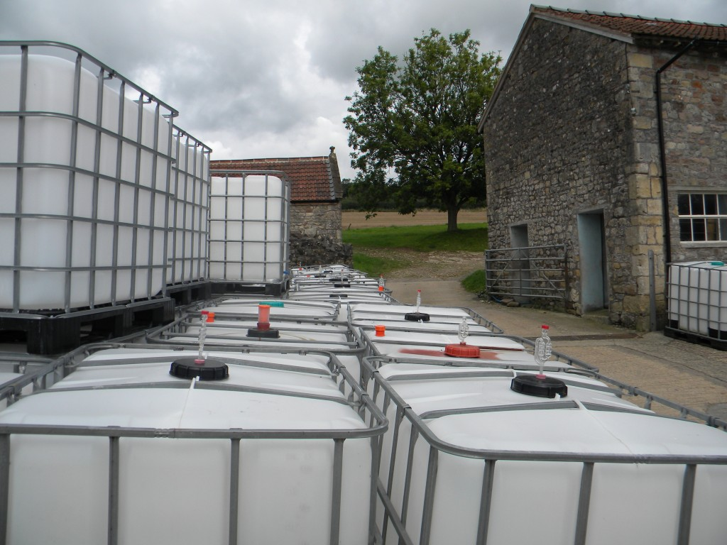 The gathering of the IBCs, ready for storing fresh-pressed apple juice